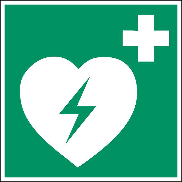 Signalétique pour indiquer la présence d'un défibrillateur.