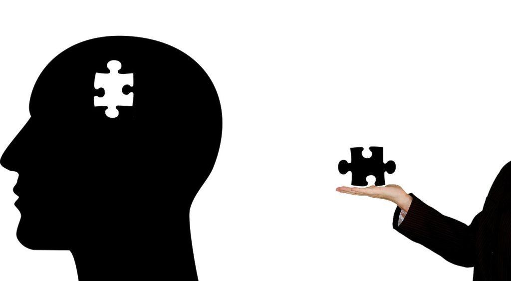 Dessin de personne de profil où il manque une pièce de puzzle.